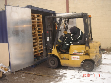 Pallets being loaded into Thermokil Kiln